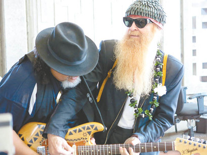 Willie K and Billy F. Gibbons serenade travelers at Kahului Airport.